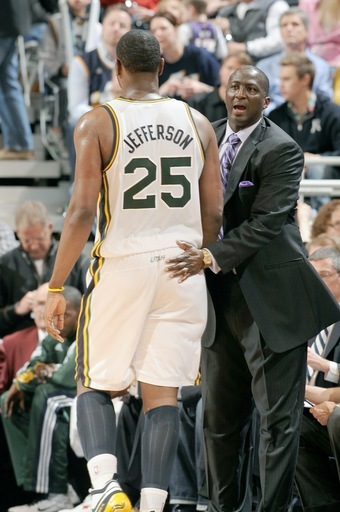 SALT LAKE CITY, UT - FEBRUARY 11:  Head Coach Tyler Corbin of the Utah Jazz encourages Al Jefferson #25 as he returns to the bench in the game against the Phoenix Suns at EnergySolutions Arena on February 11, 2011 in Salt Lake City, Utah. (Photo by Andrew D. Bernstein/NBAE via Getty Images)