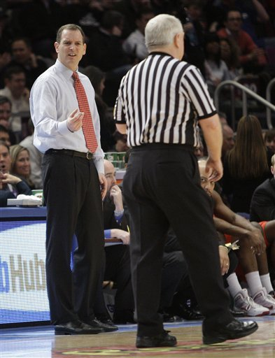 Rutgers Coach Mike Rice, Left, Argues