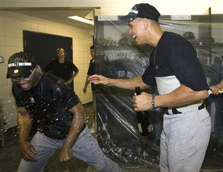 New York Yankees Third Baseman Alex Rodriguez, Right, Laughs