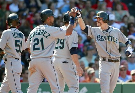 Seattle Mariners' Brendan Ryan, Right, Celebrates