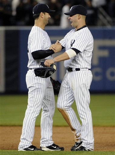 New York Yankees' Nick Swisher, Right, Celebrates