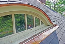 Eyebrow dormer with visible paint chipping