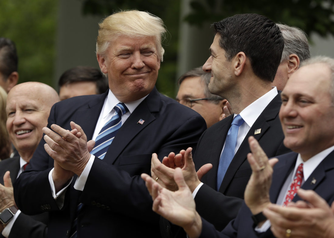 President Donald Trump talks with House Speaker Paul Ryan of Wis., in the Rose Garden of the White House in Washington, Thursday, May 4, 2017, after the House pushed through a health care bill. House Majority Whip Steve Scalise of La. is at left, and House Ways and Means Committee Chairman Rep. Kevin Brady, R-Texas is at right. (AP Photo/Evan Vucci)