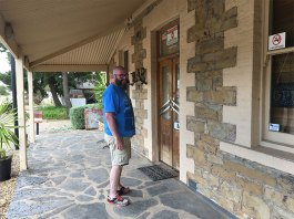 David knocking on Mount Bryan Hotel door