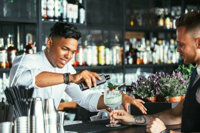 waiter and bartender pouring drink   jobs in Canada