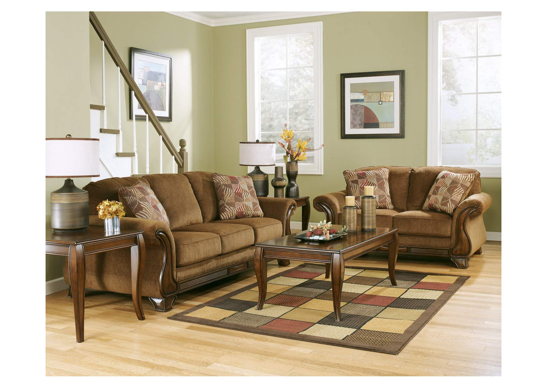 sofa and more harveys brown leather corner bay star consignments montgomery mocha loveseat signature design by ashley