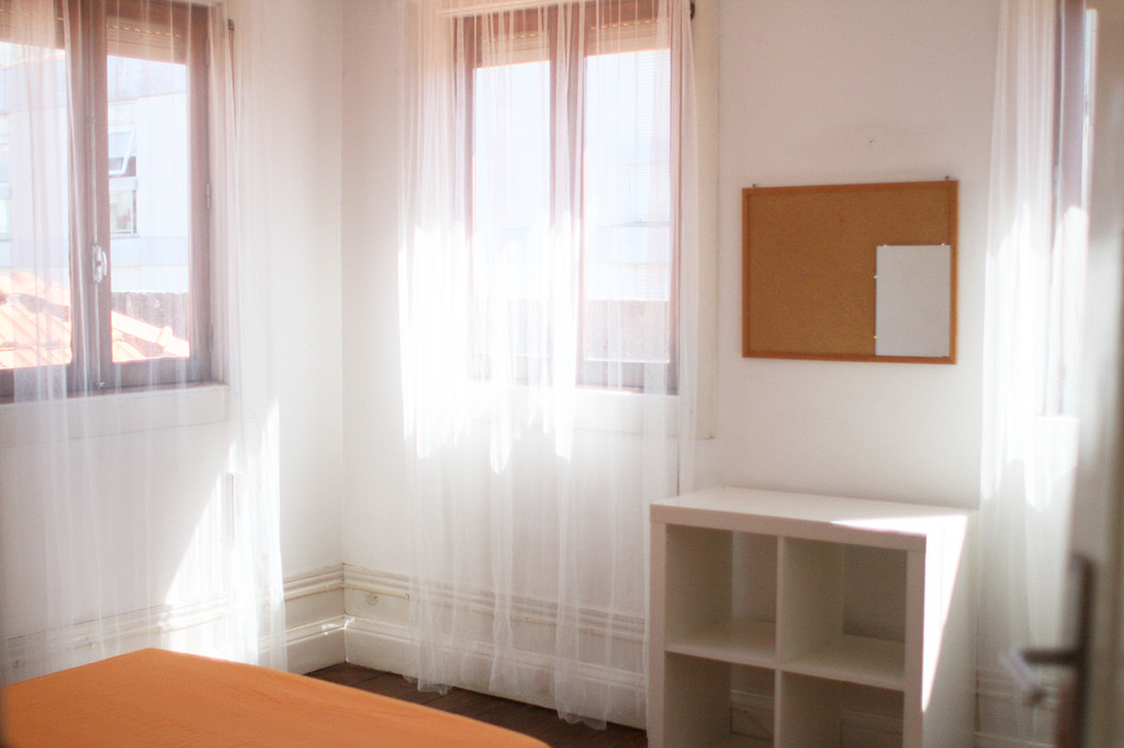 chair next to bed commode rental bright and comfy room downtown | for rent porto