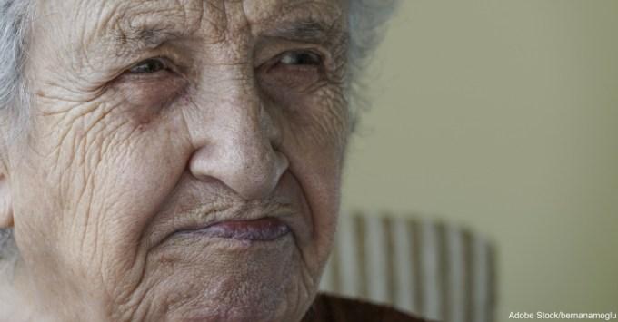 wrinkled face of senior woman