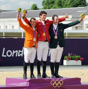 On the podium, the individual show jumping medalists: Gerco Schroder, the Netherlands, silver; gold medalist Steve Guerdat, Switzerland; Cian O'Connor, Ireland, bronze (photo copyright 2012 by Nancy Jaffer)