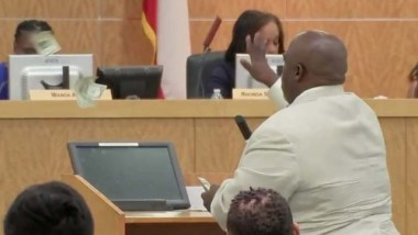 'You don't care about those kids!': Community activist throws cash at school board members