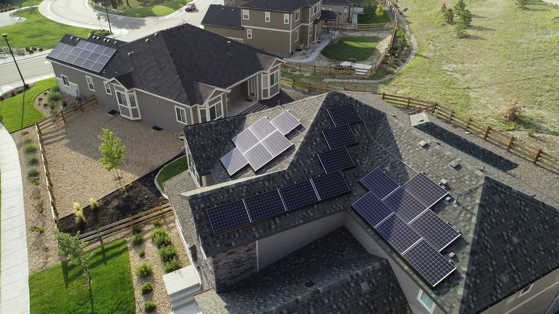 Multiple houses with solar panels on the roof, installed after getting solar energy quotes.