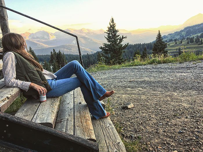 Tan flannel shirt, green vest and flares - fall look | Blue Mountain Belle