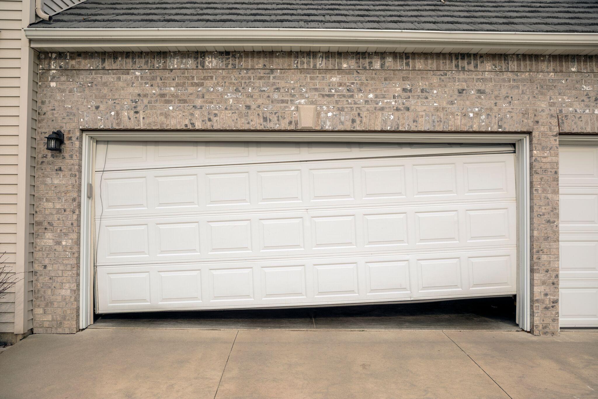 small resolution of sagging and uneven garage door