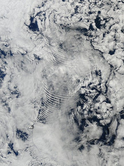 Coil-like shapes in clouds, created by their passage over the Prince Edward Islands in the south Indian Ocean. Credit: NASA/Terra/MODIS.