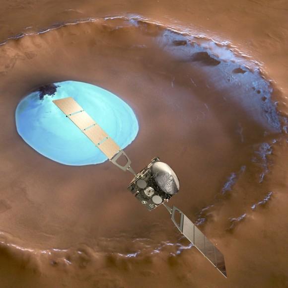 Mars Express sobre el cráter de hielo de agua. ESA celebra 10 años desde el lanzamiento del Mars Express. Este concepto artistas muestra Mars Express en contraste con un km de ancho cráter de 35 en la región de Vastitas Borealis de Marte aproximadamente 70.5 ° N / 103 ° E. El cráter contiene un parche permanente de hielo de agua que probablemente se sienta en un campo de dunas - algunas de las dunas están expuestos en la parte superior izquierda de esta imagen. Derechos de autor ESA / DLR / FU-Berlin-G.Neukum