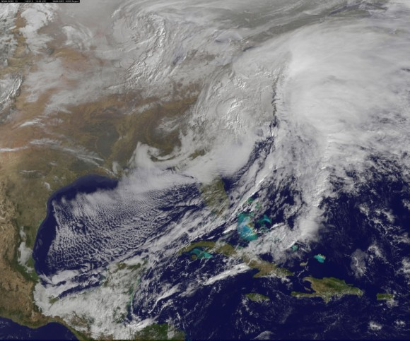 This visible image of the winter storm over the U.S. south and East Coast was taken by NOAA's GOES-13 satellite on Feb. 13 at 1455 UTC/9:45 a.m. EST. Snow covered ground can be seen over the Great Lakes region and Ohio Valley. Image Credit:  NASA/NOAA GOES Project