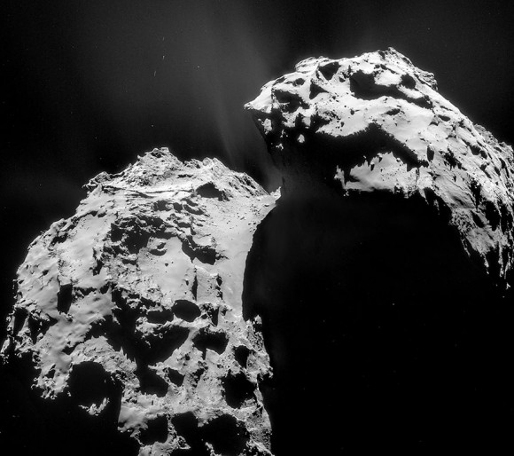 Four-image mosaic shows the overall view of the comet on January 22 photographed 17.4 miles (28 km) from its center. The larger of the two lobes is at left; Hapi is the smooth region at the transition between the lobes. Credit: ESA/Rosetta/Navcam