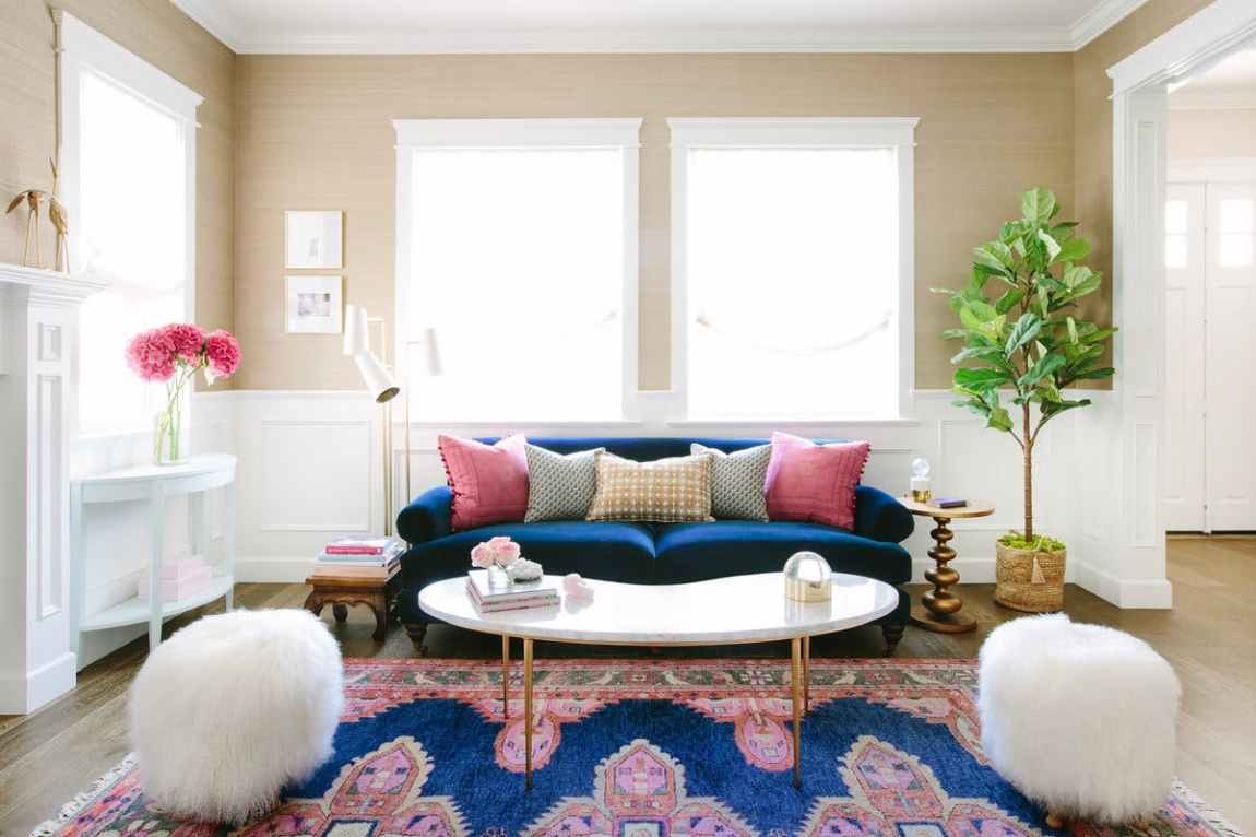 Contemporary interior with vibrant colors, beautiful symmetry and two shaggy poufs.