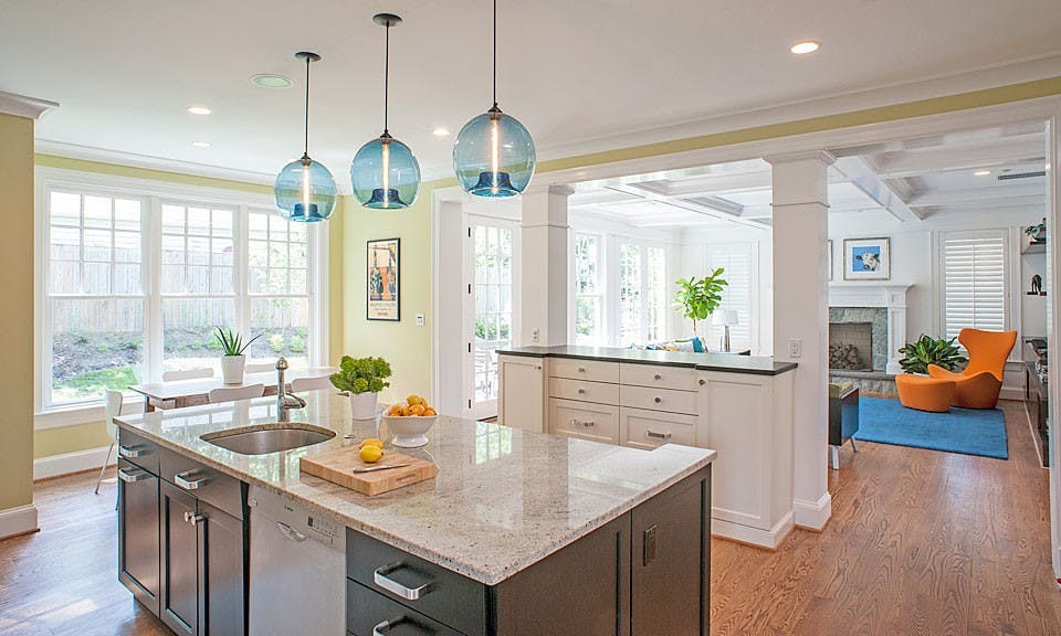 Blue glass chandeliers set off this bright, airy kitchen space.