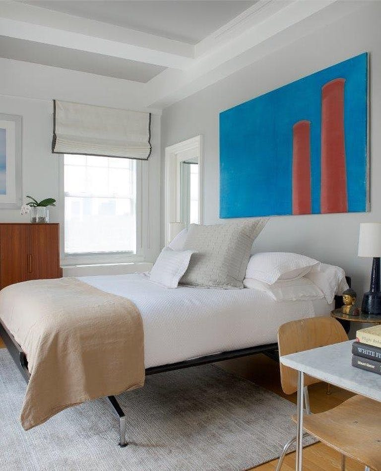 Bedroom with interesting, large-scale Modern art piece over bed