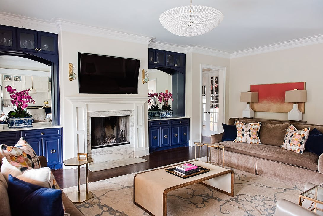 Full view of a Tradtional space set off with colorful accents and a gorgeous chandelier
