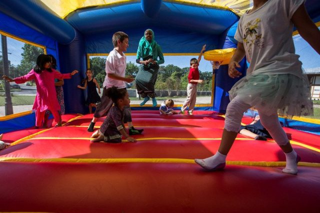 Children playing on a bouncy castle