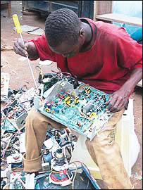 A technician fixing a damaged computer