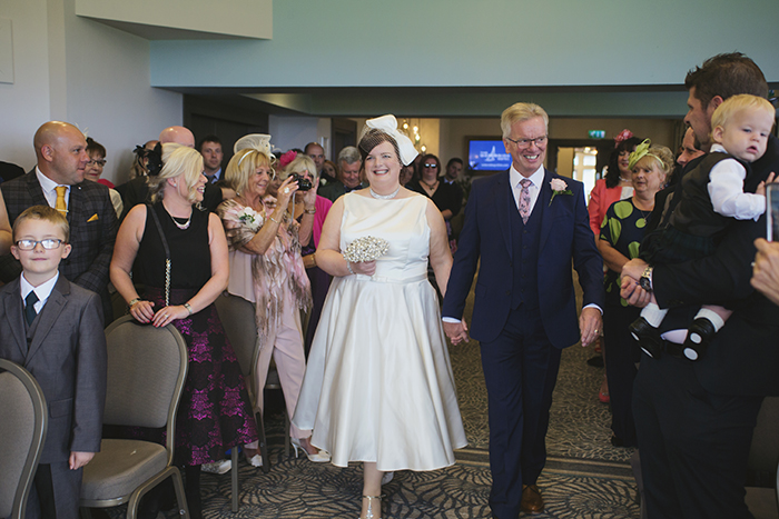 Real Wedding at The Waterside Hotel Ayrshire. Laura A Tiliman Photography. Bride walks down the aisle.