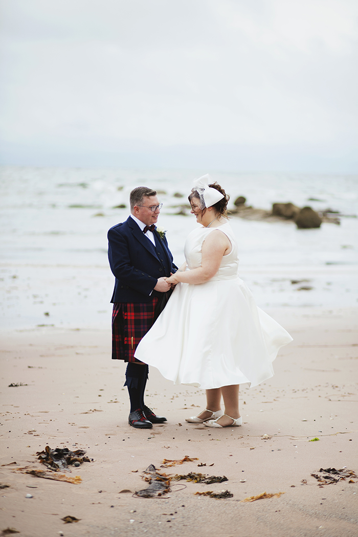 Real Wedding at The Waterside Hotel Ayrshire. Laura A Tiliman Photography. Couple on beach together