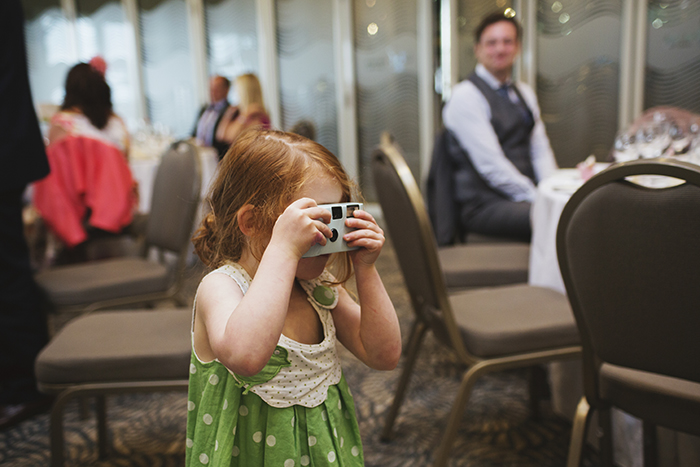Real Wedding at The Waterside Hotel Ayrshire. Laura A Tiliman Photography. Little girl with camera