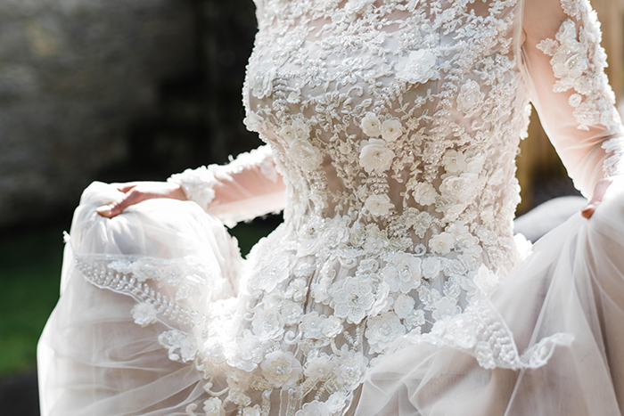 Photos by Zoe rustic PapaKåta tipi wedding - bride dress close up