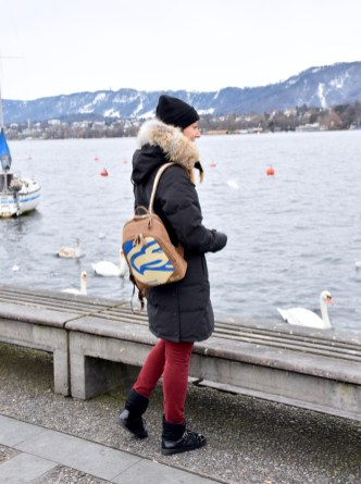 Zurich Lake, Style details: backpack - ELEPHBO, coat - CANADA GOOSE, beanie - KARL LAGERFELD, pants - MASSIMO DUTTI, boots - NAVYBOOT