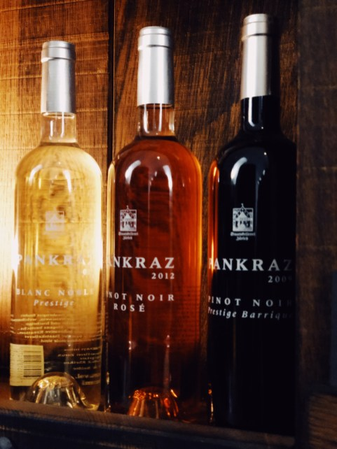 three bottles of different Pankraz wine, white, rose and red