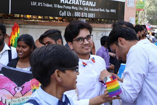 Colourful clothes, masks and rainbow flags marked the occasion.