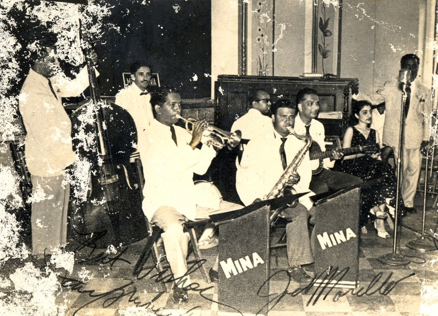 Mina Kava and the Music Makers. Kava is at the back, playing the drums.