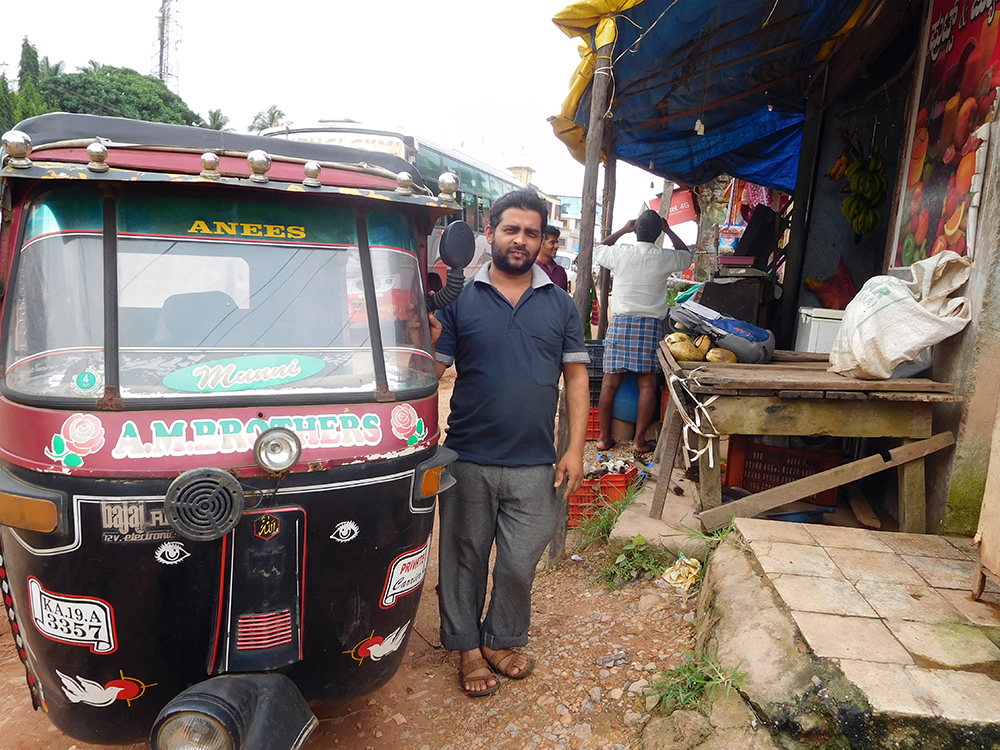 Abdul Rahouf stands near the autorickshaw, in which he took RSS worker Sharath Madivala to hospital. Photo credit: TA Ameerudheen