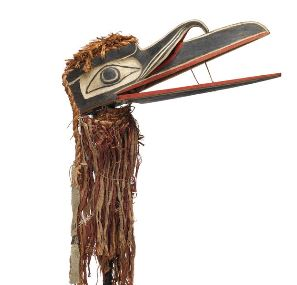 Cedar mask representing Gwaxgwakwalanuksiwe' (raven at the north end of the world), one of the bird attendants of Baxwbakwalanuksiwe', (man eater at the north end of the world). This mask is made with painted wood and shredded cedar and has been repaired with metal strips.
