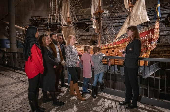 Tourists on a guided tour inside the Museum of Vasa in Stockholm