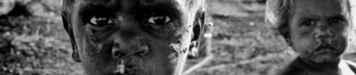 Close up black and white shot of two Australian Aboriginal children