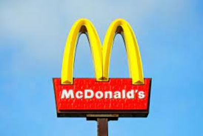 This image shows the McDonalds sign, which is a renowned symbol for foods lacking nutritional value in many societies.