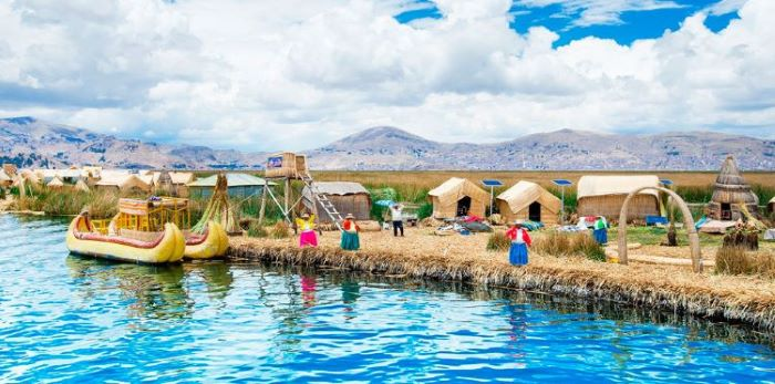 colorful locals and traditional boats of Puno & Uros islands, Peru-
