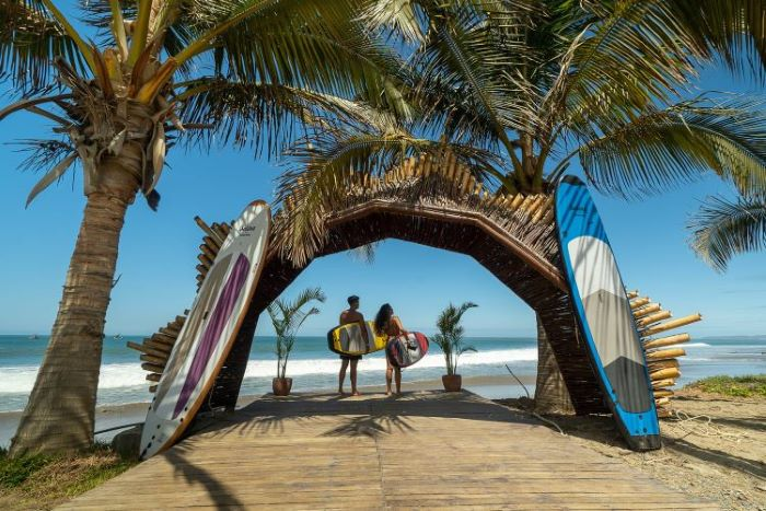 Surfing is very popular at the beaches of Mancora town, Peru