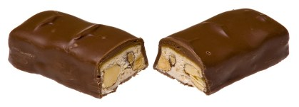 Two broken pieces of Mars with a velvety layer and nougat stuffed