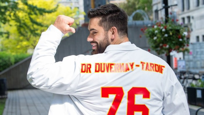 Laurent Duvernay-Tardif showing off his new uniform. The back of the uniform has his number (76) and his name as Dr Duvernay-Tardif.