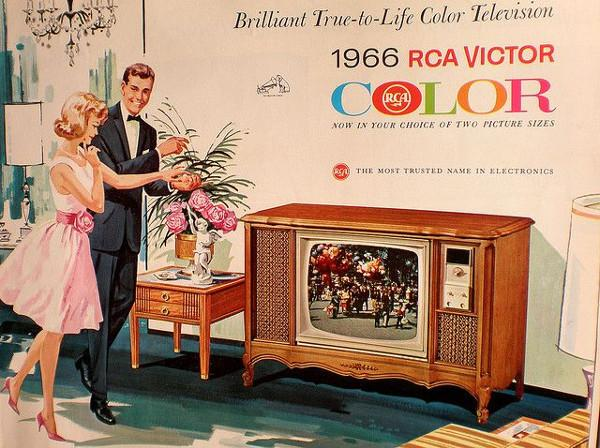 A advertisement for RCA Victor color television. The poster is a color drawing of a man and woman admiring a television set.