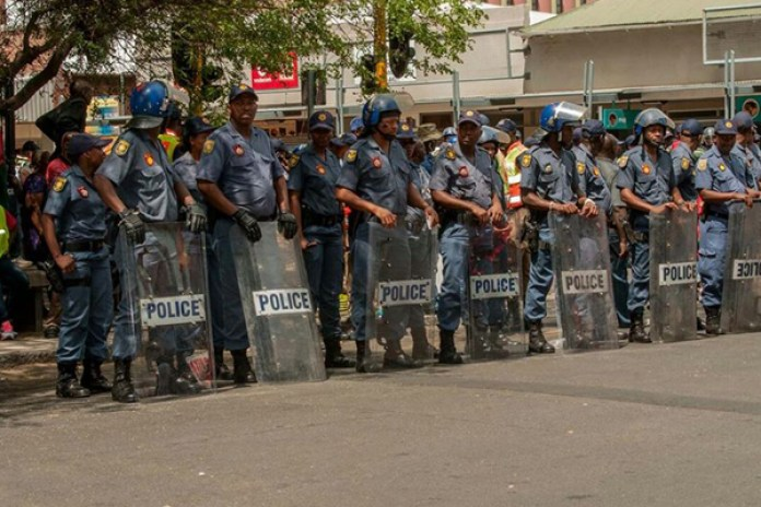 a group of African police aligned to hinder the public from moving further