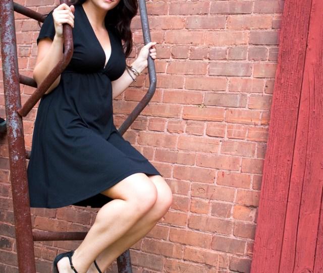 A Beautiful Young Woman In Her Twenties Posing In A Run Down Urban Setting On A