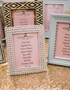 Mismatched frames with pink seating charts for tables also invitations  more photos diy framed inside weddings rh insideweddings