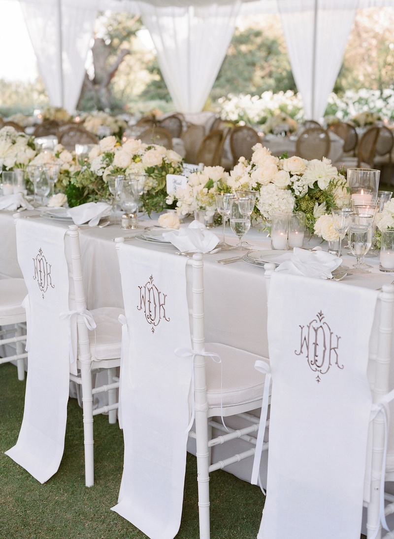chair covers at wedding reception upholstered counter height chairs decor photos monogram inside weddings white linen with