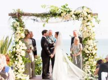 Couples Photos - Couple Exchanges Vows Under Wooden ...
